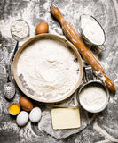 Preparation of the dough. Ingredients for the dough - Sieve flour, sour cream, butter, eggs with a rolling pin. Stock Image