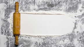 Preparation of the dough. The rolling pin with flour on a stone background. Stock Image