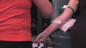 Preparation and drawing blood from donor stock footage