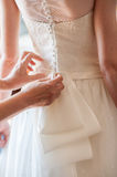 Preparation and dressing of the bride Stock Photography