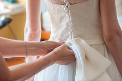 Preparation and dressing of the bride Stock Image