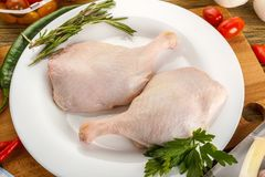 Preparation of duck legs. Formulation, components. Composition,. Kitchen table. The view from the top. Raw duck Stock Photos