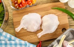 Preparation of duck legs. Formulation, components. Composition,. Preparation of duck legs with black . Formulation, components. Composition, kitchen table. The Royalty Free Stock Photos