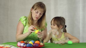 Preparation of easter eggs, the feast of the passover. Decorate easter eggs with paints stock footage