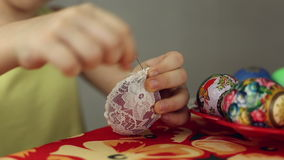 Preparation of Easter eggs, the feast of the passover. Decorating Easter eggs lacy cloth stock footage