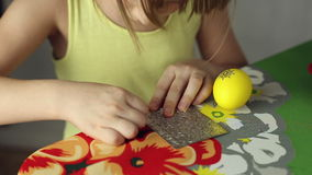 Preparation of Easter eggs, the feast of the passover. Girl sticks decorative stickers on the Easter eggs stock video