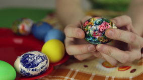 Preparation of Easter eggs, the feast of the passover. Girl sticks decorative stickers on the Easter eggs stock footage