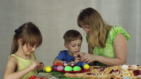 Preparation of Easter eggs, the feast of the passover. Sticking decorative stickers on the Easter eggs stock video