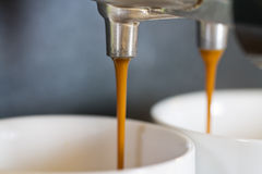 Preparation of espresso coffee. To two cups Stock Image