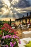 Preparation of an event at a classic Tuscan villa. Illuminated by special rays of sunlight that cross the clouds Stock Photography