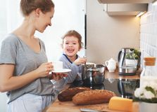 Preparation of family breakfast. mother and child daughter cook Stock Photos
