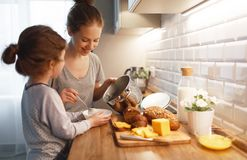 Preparation of family breakfast. mother and child daughter cook Royalty Free Stock Images