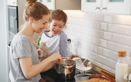 Preparation of family breakfast. mother and child daughter cook Stock Images