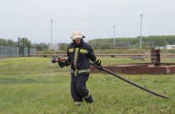 Preparation for fire fighting. SZEGED, HUNGARY - October 8, 2015: Regional fire-fighting exercise in the training area with urban and contract firefighters Stock Photography