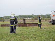 Preparation for fire fighting. SZEGED, HUNGARY - October 8, 2015: Regional fire-fighting exercise in the training area with urban and contract firefighters Royalty Free Stock Photos