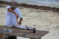 Preparation of fish for wedding party on the beach Royalty Free Stock Photography