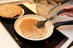 Preparation of flaxseed meal pancake Royalty Free Stock Images