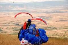 Preparation before flight. Paragliders are preparing to fly.  Paragliding  in Macedonia Stock Photo