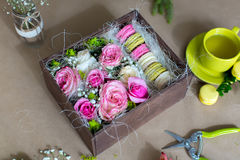 Preparation of flower box with macaroons Stock Photos