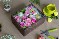 Preparation of flower box with macaroons Royalty Free Stock Photo