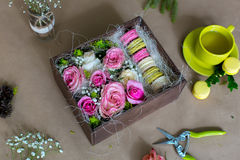Preparation of flower box with macaroons Royalty Free Stock Photos