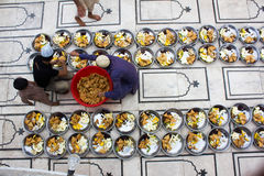 Preparation of food for breaking fast. Kids get ready with food for breaking fast (Known as Iftari in Urdu) at a famous mosque in Karachi Pakistan known as Memon Royalty Free Stock Photography
