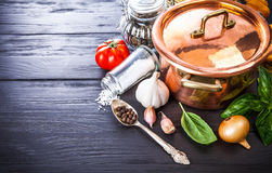 Preparation food copper pan with vegetables and Royalty Free Stock Photo