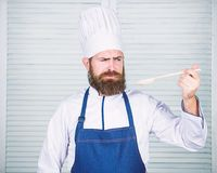 Preparation of food. Healthy food cooking. Bearded man cook in kitchen, culinary. Chef man in hat. Secret taste recipe stock photography