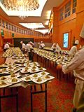 Preparation of food for serving guests. Cooks and chefs prepare appetisers for waiters and waitresses to bring into the ballroom to serve the guests at their Royalty Free Stock Photo