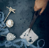 Preparation For The Holiday - Hand With Old Scissors Christmas Decorations - Lace, Star, Ball, Bump. Top View Stock Photos