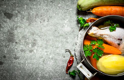 Preparation of fragrant chicken soup with fresh vegetables Stock Images
