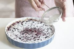Preparation of a French pie with cherries. Clafoutis cherry pie. stock photos