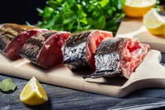 Preparation of fresh fish to fry Royalty Free Stock Images