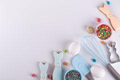 Preparation of gingerbread cookies. Easter cookies in the shape of a funny rabbit , tools necessary to make gingerbread pastry,. Colored sprinkles. Easter stock photos