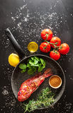 Preparation of a grilled fish Royalty Free Stock Photos