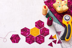 Preparation of hexagon pieces of fabric for sewing a quilt Grand. Mother`s Flower Garden stock photos