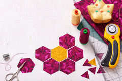 Preparation of hexagon pieces of fabric for sewing a quilt Grand Stock Photo
