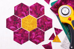 Preparation of hexagon pieces of fabric for sewing a quilt Grandmother`s Flower Garden Stock Photo