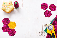Preparation of hexagon pieces of fabric for sewing a quilt Grandmother& x27;s Flower Garden Royalty Free Stock Photo