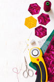 Preparation of hexagon pieces of fabric for sewing a quilt Grandmother& x27;s Flower Garden Stock Photo