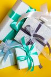 Gift box on yellow background stock photos