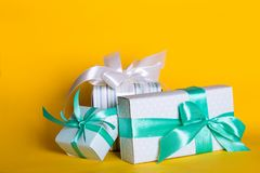 Gift box on yellow background royalty free stock photos