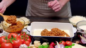 Preparation of homemade lasagna stock video footage
