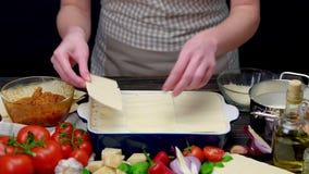 Preparation of homemade lasagna stock video