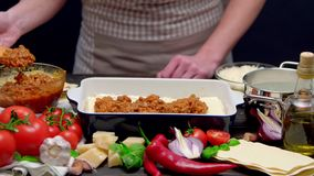 Preparation of homemade lasagna stock footage