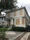 Preparation for Hurricane Irma. Homeowners in downtown Charleston take precautions to their homes from from strong winds of Hurricane Irma Royalty Free Stock Photography