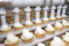 Preparation of ice-cream on factory. Preparation of tasty ice-cream on factory Stock Photo