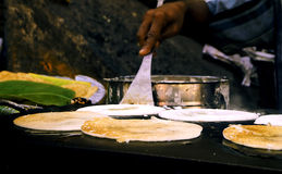Preparation of the Indian pizza aka dosa Stock Image