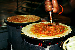 Preparation of the Indian pizza aka dosa Stock Photo