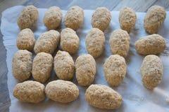 Preparation of Italian fried rice balls. Preparing Italian fried rice balls or arancini Stock Photos